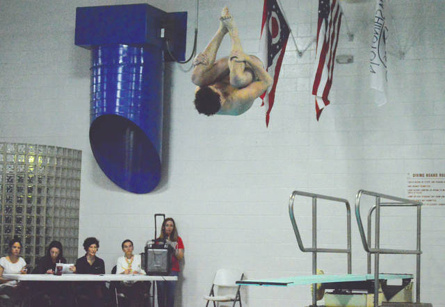 Beavercreek's Mason Kennedy, shown here diving in a December meet in Centerville, holds one of the area's Top-5 times in the boys 100-yard freestyle.