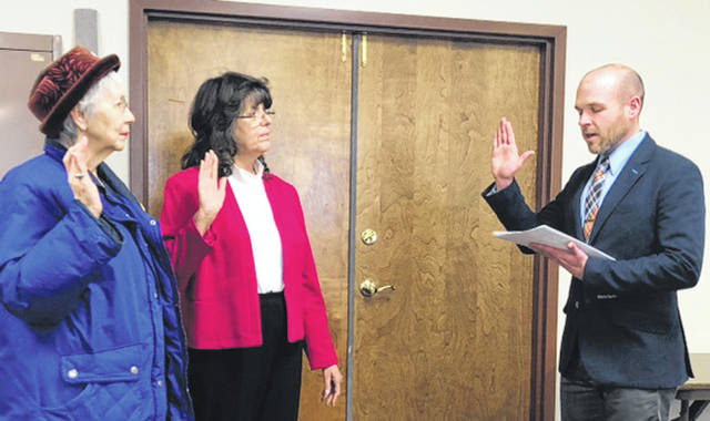 Submitted photo Clerk of Courts AJ Williams administers the oath Feb. 19 to Doris Adams and Jan Basham. The women were sworn in to begin their new terms on the Greene County Board of Elections.