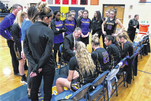 Scott Halasz | Greene County News Bellbrook High School girls basketball coach Jason Tincher draws up a play during a timeout Feb. 2 at Monroe High School. The Golden Eagles won, 46-34, behind 21 points from sophomore Bailey Zerby.