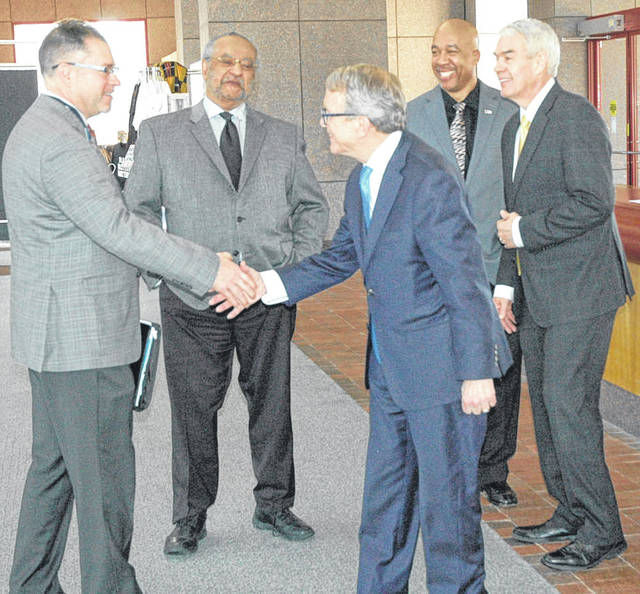 Gov. Mike DeWine greets folks as he enters the National Afro-American Museum & Cultural Center in Wilberforce.