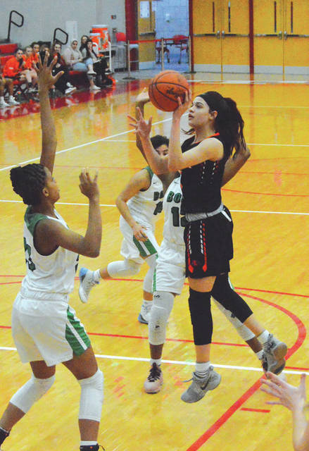 Beavercreek sophomore guard Alyssa Hargrove-Hall puts up a shot in the first half of a Division I girls high school basketball sectional tournament game against Northmont, Feb. 19 at Troy High School.
