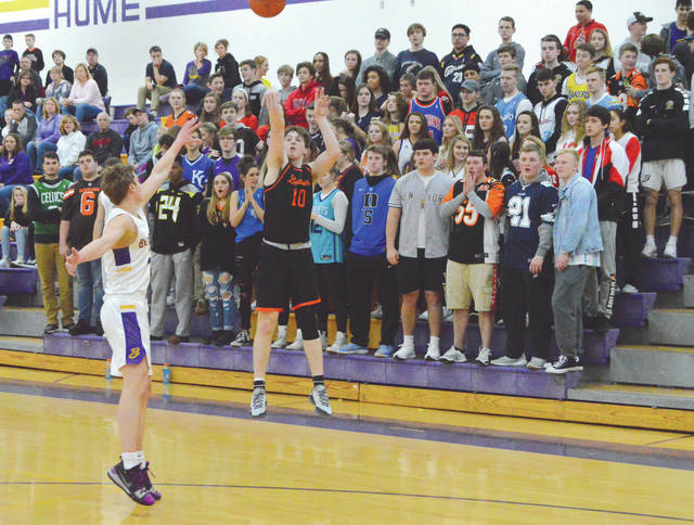 In front of the Bellbrook student section, Beavercreek's Chris Herbort fires a 3-pointer, in first-half action Feb. 9 at Bellbrook High School. Herbort led Beavercreek with 13 points in a 55-39 win.