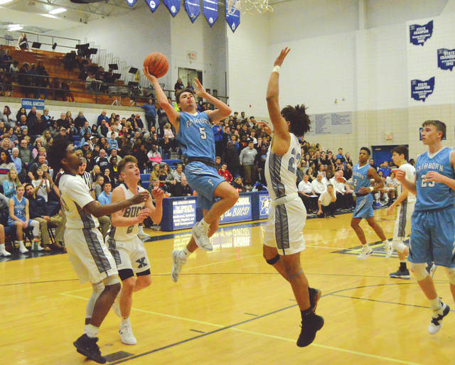 Fairborn senior Joe Nickel goes in for a score, during the second half of Friday's Feb. 15 boys high school basketball game at Xenia High School.
