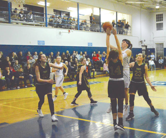Legacy Christian senior Emily Riddle scores the 1,000th point of her career, Feb. 7, in the third quarter of the team's 53-20 win over visiting Troy Christian.