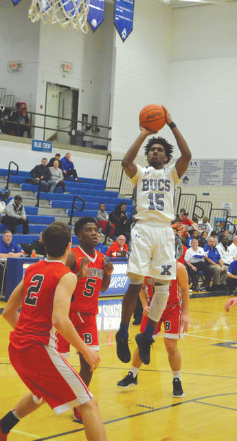Samari Curtis (15) puts up a jump shot in the first half of Tuesday's Feb. 6 boys high school basketball game against visiting Bellefontaine. Curtis set the Xenia school record for most points in a single game with 52 in a 90-55 Buccaneers win.