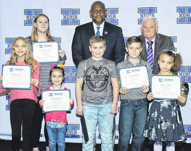 Photo courtesy Xenia School District The Xenia board of education recognized its kids of character at the Feb. 11 meeting. Pictured with Superintendent Dr. Gabe Lofton and Board President Dr. Robert P. Dillaplain are Liliann Holston (Arrowood), Kaylee Norfleet (McKinley), Cecil Piner (Shawnee), Landen Moorman (Tecumseh), Trinity Wiley (Warner), and Bristyl Dean (high school). Not pictured is Kade King (Cox).