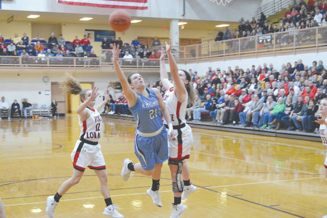 Legacy Christian sophomore Kathleen Ahner (21) scored a game-high 19 points in a Division IV regional semifinal loss to No. 1-ranked Fort Loramie, March 7 at Butler High School in Vandalia.