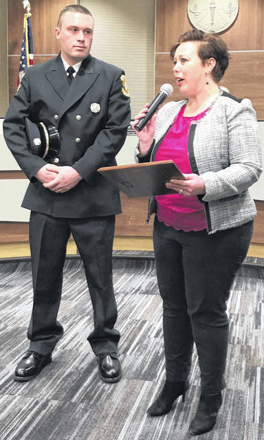 Scott Halasz | Greene County News Xenia Mayor Sarah Mays reads a proclamation declaring Feb. 28 Levi Dalton Day in Xenia. While off duty, Dalton helped save the life of a 17-month-old girl.