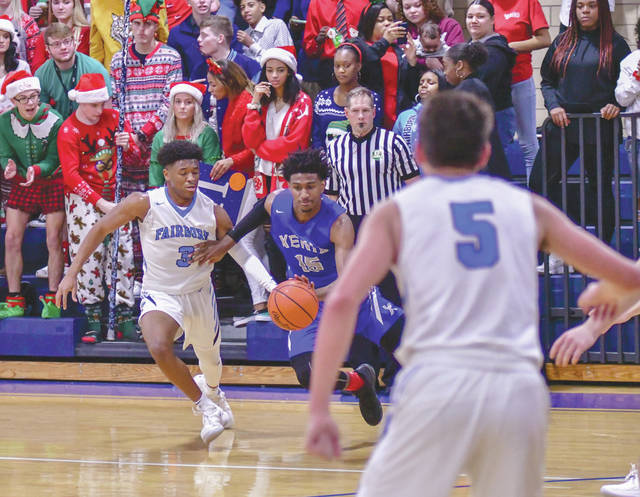 In a more holiday atmosphere on Dec. 20, 2018, Xenia's Samari Curtis (15) drives against Fairborn's Shaunn Monroe (3) in a Greater Western Ohio Conference battle in Fairborn. Both players were selected to the Division I All-Ohio team, with Curtis being named Player of the Year.