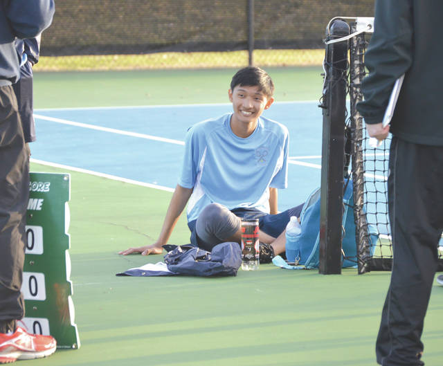 Fairborn's Janiel Buita smiles and rests moments after winning the decisive match at third singles, to give the host Skyhawks a 3-2 team win over Middletown, March 27 at Community Park in Fairborn.