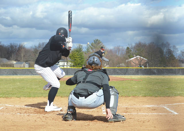 A Beavercreek pitcher blows a baseball by a Beavers batter, or at least that the alliterative story we're going with. Beavercreek High School players competed in an intrasquad scrimmage March 22 on the Mark Stewart Baseball Field.