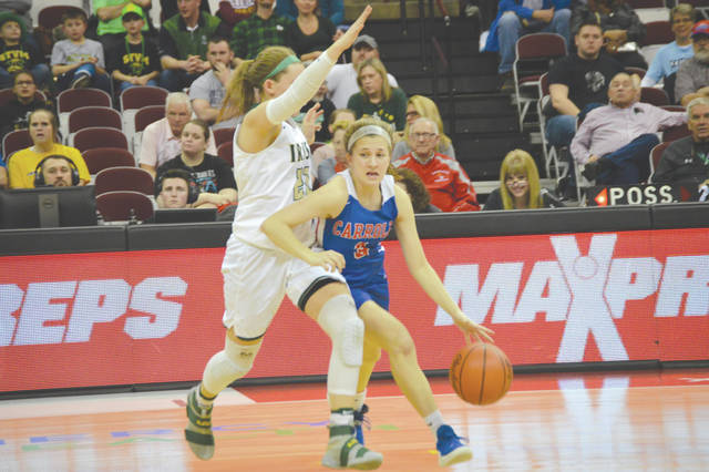Five-foot-five freshman Sarah Ochs (3) of Carroll drives around 5-10 Akron St. Vincent-St. Mary senior guard Sydney Korinek, in the first quarter of Thursday's Division II state semifinal girls high school basketball game in Columbus. Ochs scored a game-high 14 points in Carroll's win.