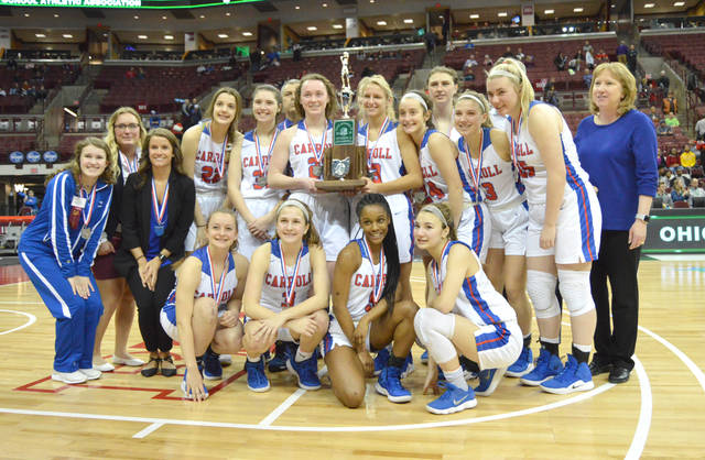 The 2018-'19 Carroll High School girls basketball team poses with the Division II state runner-up trophy, March 16 at the Jerome Schottenstein Center, on the Ohio State University campus in Columbus.