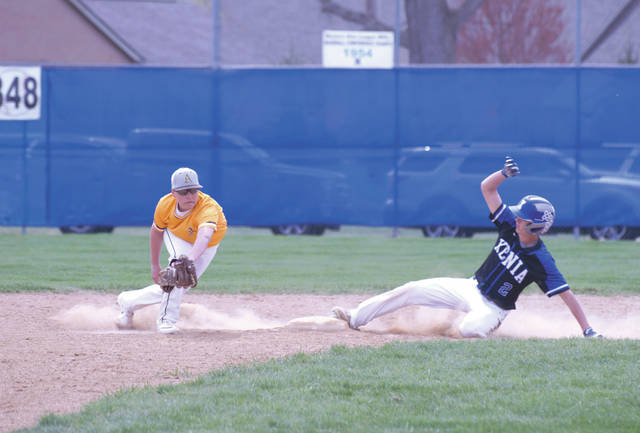 Xenia's Blayne Dudley slides safely into second base. He would later tie the game by stealing home in the Buccaneers' first-game win over Kettering Alter, April 13 at Xenia High School.