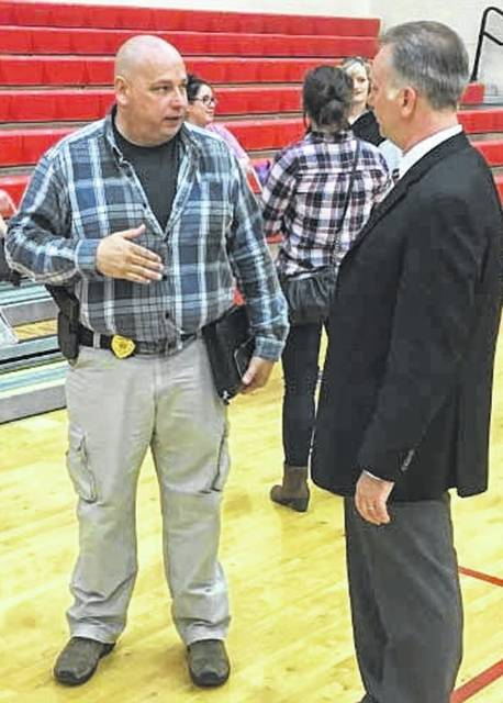 Cedar Cliff Superintendent Chad Mason discusses school safety with the new Cedarville Police Chief Jimmy Combs following a community meeting regarding added security measures.