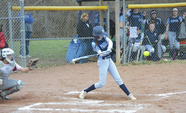 Fairborn junior outfielder Riley Davis fouls off a pitch in the third inning of Friday's loss to Troy at Community Park.