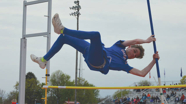 Greeneview's Kevin Combs clears a preliminary height during the pole vaulting competition April 24 at the Greeneview Quad H.S. track and field meet in Jamestown. Combs had a busy day. He won the 110-meter hurdles and the high jump competitions, finished second in the pole vault and fourth in the 100 dash.