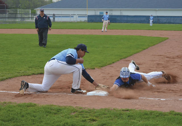 Fairborn first baseman Kahlil Lettice applies the tag to pickoff Xenia's Sam Lockwood in the third inning of an April 30 high school baseball game at Fairborn High School.