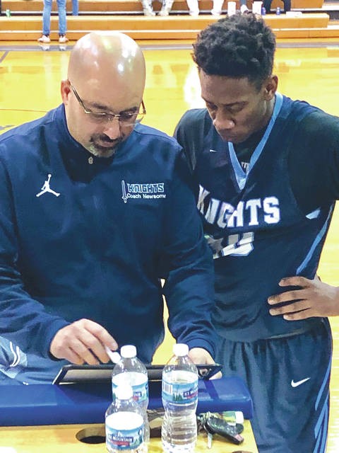 Brad Newsome (left) goes over a play with Legacy Christian basketball player Keano Hammerstrom during the 2019 season. Newsome, who was named Metro Buckeye Conference Coach of the Year, was fired as the team's coach on April 9.