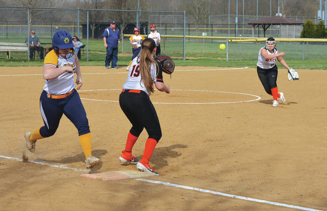 Springfield's Taryn Freer beats out a throw from Beavercreek pitcher Mariah Crawford to first baseman Hannah Walters in the first inning of Monday's April 8 girls high school softball game at Rotary Park in Beavercreek.