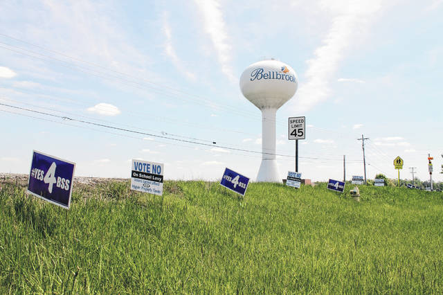 Anna Bolton | Greene County News Campaign signs for and against the Bellbrook-Sugarcreek Local School District levy line a Bellbrook street May 6, the day before the special election.
