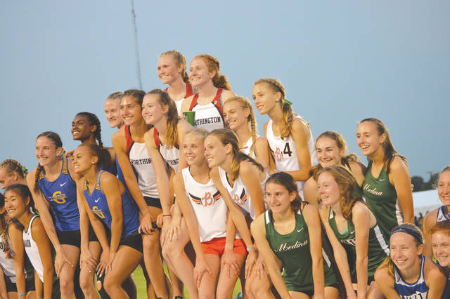 Beavercreek's girls 3,200-meter relay team of Savannah Roark, Juliann Williams, Jodie Pierce and Taylor Ewert (4) turned in a season-best time in the Division I championship race, finishing third, May 31 at Ohio State University's Jesse Owens Memorial Stadium in Columbus.