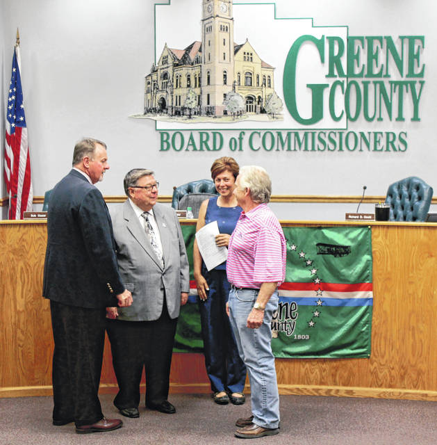 Anna Bolton | Greene County News Greene County Commissioners Dick Gould and Bob Glaser speak with Greene County Engineer Bob Geyer and Chief Deputy Stephanie Goff, who was appointed as acting county engineer at the May 16 meeting.