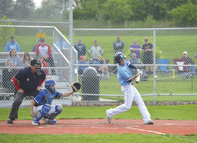 Fairborn junior Jacob Hobbs fouls off a pitch, during an April 30 home baseball game against Xenia.