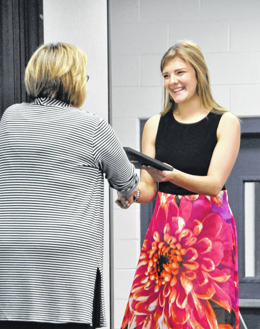 Lilian Salmons, a junior Health Science student from Xenia, receives her certificate as a new member Greene County Career Center's chapter of the National Technical Honor Society. Dr. Pamela Downing, Director of Secondary Education, presents her award.