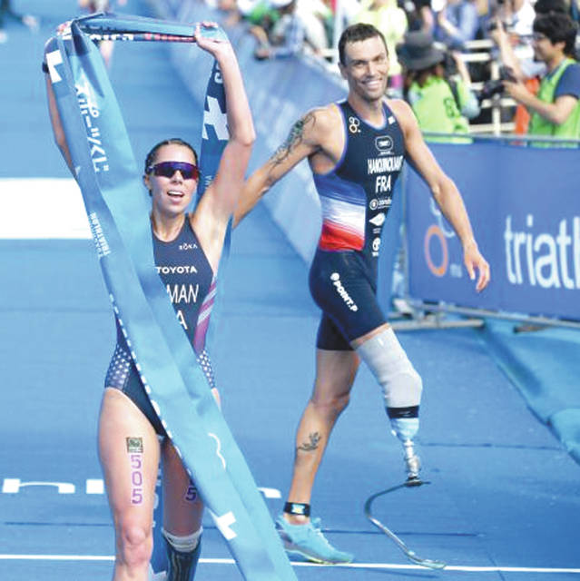 Grace Norman (left) celebrates after winning the women's PTS5 division race of the ITU World Paratriathlon Series event, May 18 in Yokohama, Japan.
