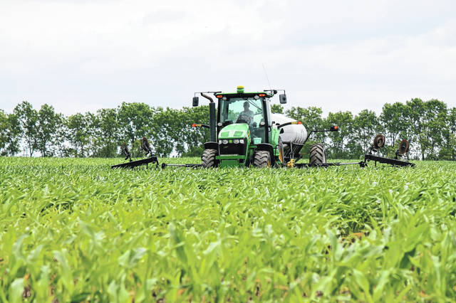 Anna Bolton | Greene County News A farmer sprays his cornfield in Cedarville June 24. Parts of the field may be just knee-high by the Fourth of July.