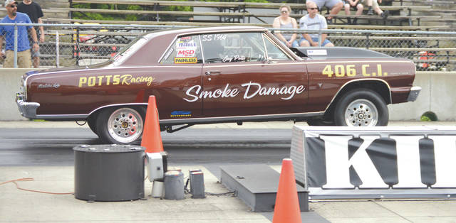 The front wheels of Jay Potts' Chevy Chevelle get airborne during a test run, Thursday June 6 at Kil-Kare Dragway in Xenia Township.
