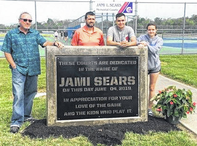 Submitted photo The tennis courts at Frank Seaman Park in Jamestown were renamed to honor Jami Sears, a former coach who died earlier in the spring. Pictured are members of her family: father, Steve Daughtery; husband, Jess Sears; and children Zane and Zoe Sears.