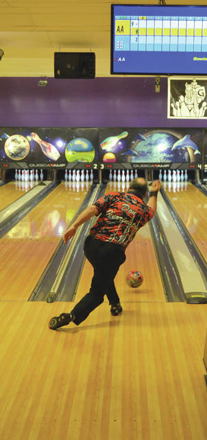 Don Herrington, of Ballston Lake, N.Y., follows through on his shot during qualifying for the PBA50 Tour's Fairborn Central Classic, presented by Roto Grip, July 2 at Bowl 10 Lanes in Fairborn. Herrington finished third out of 39 bowlers to advance to Wednesday's match-play round.