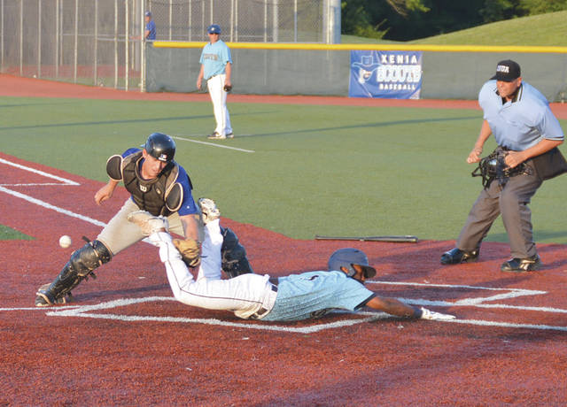 Xenia's Jarrett Eaton scores on this head-first slide, off teammate Hunter Delanoy's sacrifice fly to left field, in the fifth inning of Tuesday night's game at Grady's Field, on the Athletes In Action Sports Complex grounds.