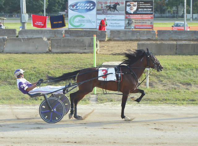 "Referring to the Chip Noble Memorial Race Track as ""home,"" Dan Noble of Xenia, shown here winning aboard Indeed A Dream, had five race winners during Wednesday's first day of harness racing at the Greene County Fair."