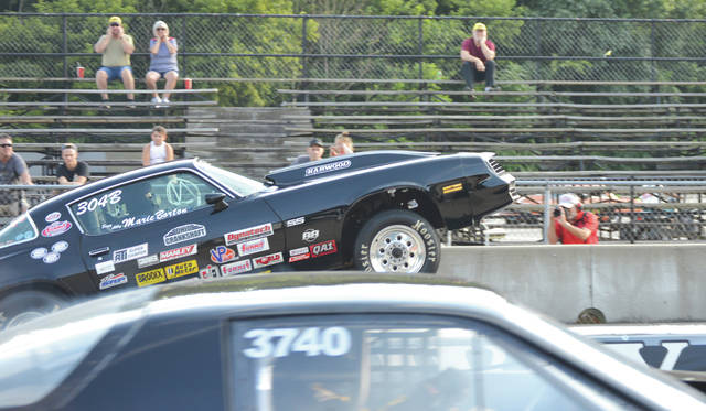 The Camaro driven by Phil Borton, of Urbana, gets into a wheelstand during a qualifying run with Josh Perk of Piqua, during Friday's Super Gas division Double Up Shootout at Kil-Kare Dragway in Xenia Township.