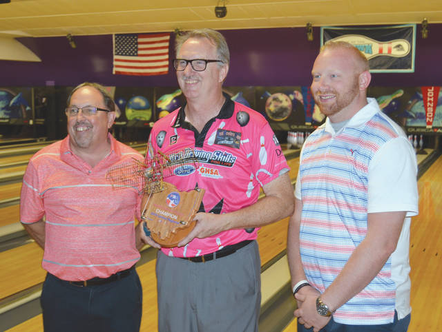 Walter Ray Williams poses with the Fairborn Central Classic trophy between Bowl 10 proprietor and tournament host Dave Flemming (left) and Bowl 10 manager Jay Rapp, after Wednesday's July 3 PBA50 Tour win in Fairborn.