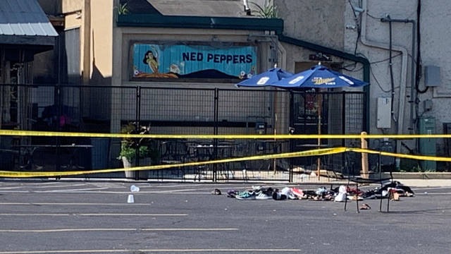 Police have taped off the area around Ned Peppers Bar on E. Fifth Street in Dayton's historic Oregon District. A gunman killed 9 victims and injured 26 others in a mass shooting early Saturday morning.