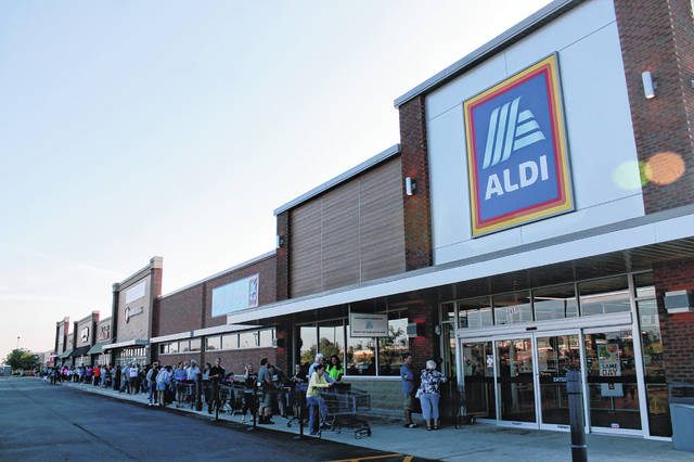 Anna Bolton | Greene County News Shoppers line up for the Beavercreek ALDI re-opening Aug. 15. Some had been waiting since 4 a.m.