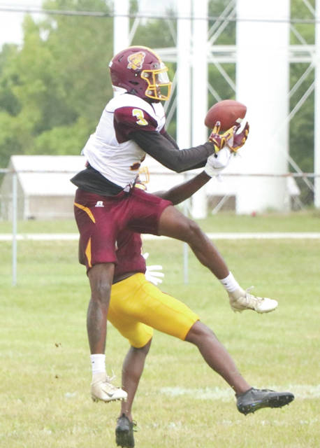 Kevin Greenhow (3) leaps to make a catch, during a Central State University football team practice session earlier this week in Wilberforce.
