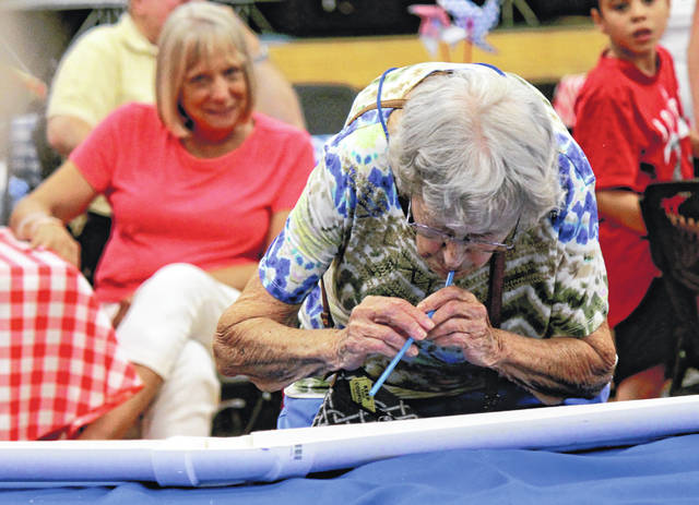 Anna Bolton | Greene County News Visitors shop, eat, and watch the Cloud Racing Tournament at Greene County Council on Aging's Homemade Treats & Jam Fest Aug. 14 at the Xenia Community Center. The annual event, benefiting senior and caregiver services, includes games, live music, raffles and auctions.