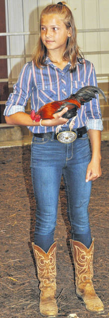 Scott Halasz | Greene County News Whitney Eavers and her first-place hen.