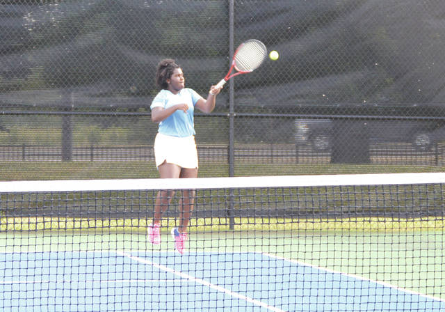 Fairborn freshman Eva Gibson hits a forehand from the baseline during Tuesday's first singles match against Carroll, at Community Park.