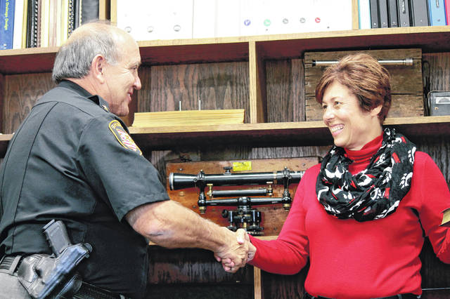 Anna Bolton | Greene County News Sheriff Gene Fischer swears-in Greene County Engineer Stephanie Goff Aug. 2. Former Logan County Engineer Jim Cox holds the Bible.
