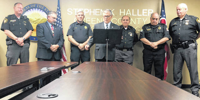 Scott Halasz | Greene County News Greene County Prosecutor Stephen Haller announces he is running for re-election. He is joined at the podium by various county law enforcement officials.