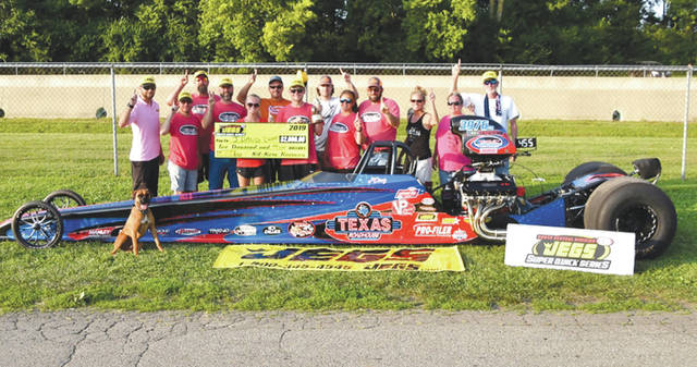 Jay Oakley of Philpot, Kentucky won the Sunday JEGs Super Quick Series drag racing final to clinch the Series' season points title. Oakley, his family and team celebrate the July 28 win at Kil-Kare Dragway in Xenia Township.