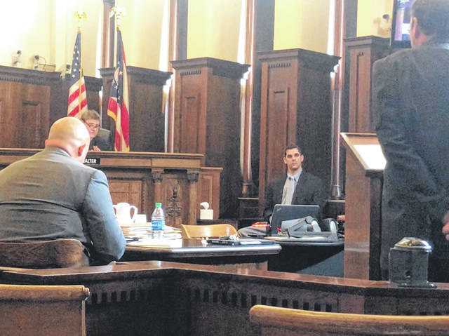 Anna Bolton | Greene County News Judge Michael Buckwalter holds up a time-out hand signal as defendant Justin Reeves responds to questions from Assistant Prosecutor Bill Morrison during trial Aug. 14.