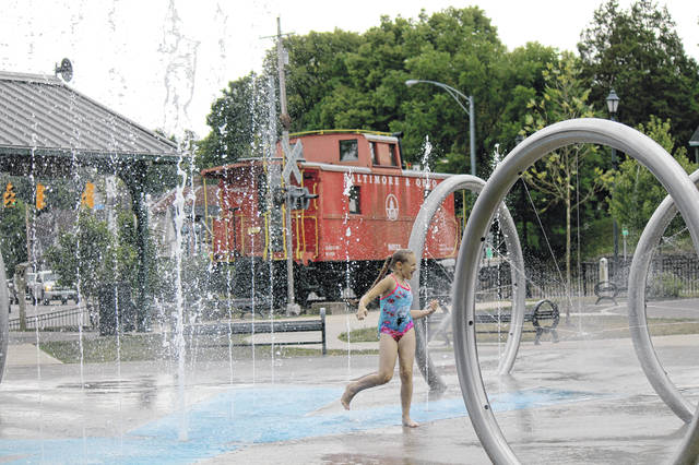 Anna Bolton | Greene County News Kids take advantage of the last days of summer by playing at Xenia Station's playground and splash pad Aug. 12.