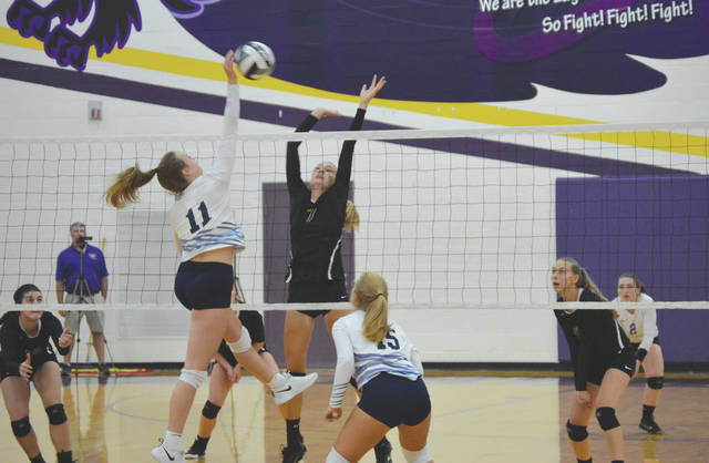 Bellbrook's Mallory Gedeon (7) goes up to try and block a shot from Claire Henson of Valley View, during a girls high school varsity volleyball game Aug. 27 at Bellbrook High School.
